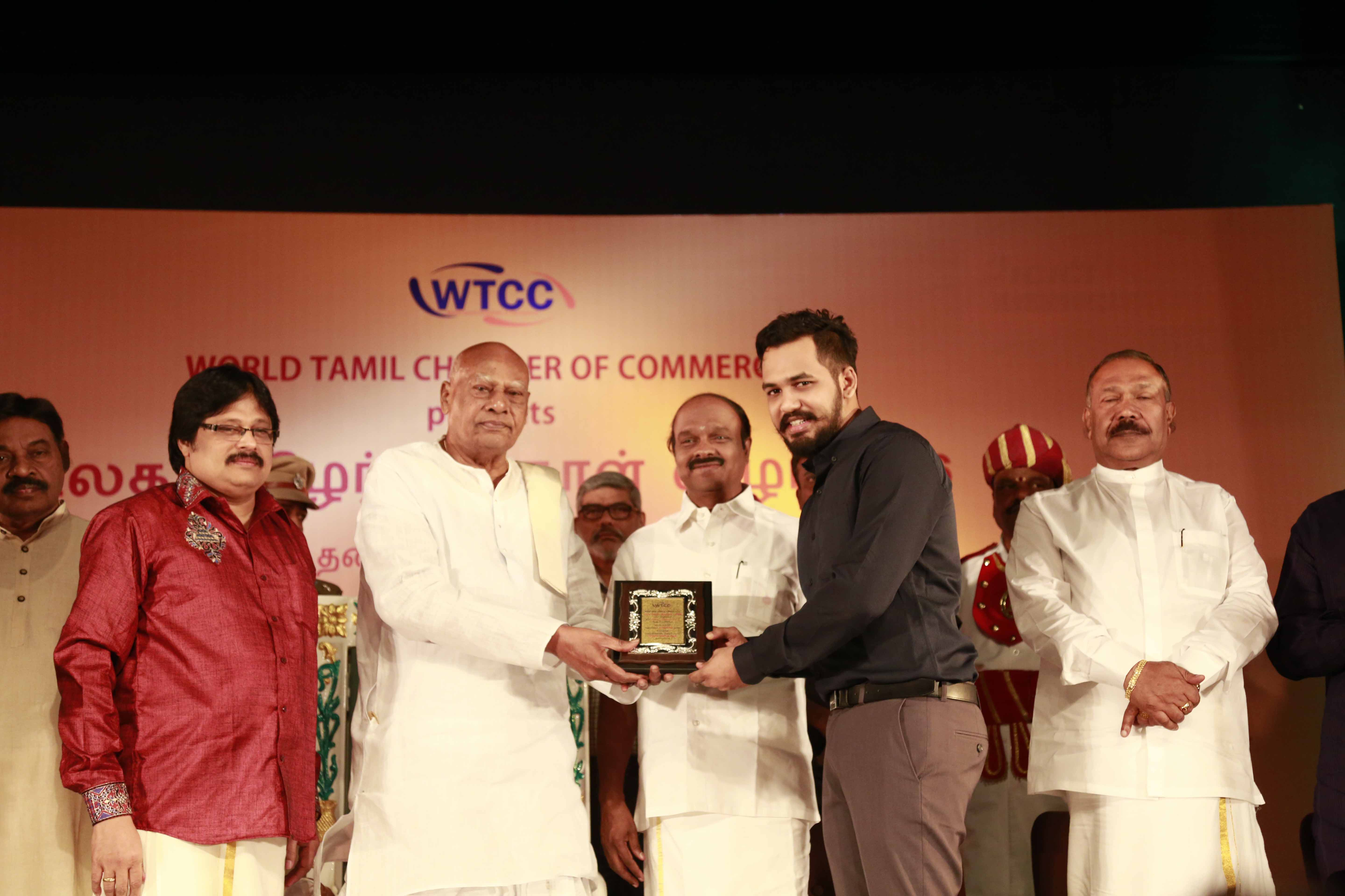 Governor honoring Hip Hop Thamizha, the Sadhanai Tamilan Award